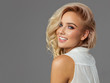 Leinwanddruck Bild - Beautiful blond smiling woman