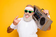 Leinwanddruck Bild - Cheerful excited aged funny active sexy athlete cool pensioner grandpa in eyewear with bass clipping ghetto blaster recorder. Old school, swag, sticking tongue, fooling, gym, workout, technology