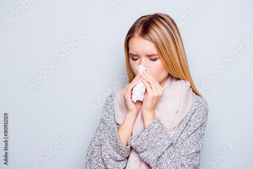 Fotografia, Obraz  Closeup portrait of beautiful charming attractive woman sneezing in a tissue blo