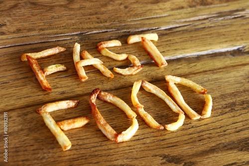 Obraz na plátně  pommes schrift fast food I