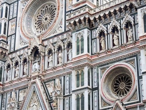 Fotografie, Obraz  Statues and facade of the front of the Catterdrale di Santa del Fiore or Duomo d