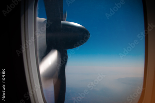 Fényképezés  view of turboprop plane propeller seen through the window during flight