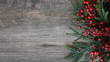 canvas print picture Christmas Evergreen Branches and Berries Over Rustic Wood Horizontal Background