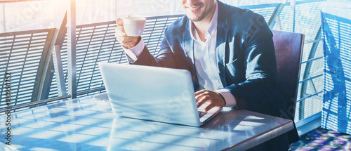 businessman working on computer, drinking coffee and smiling, abstract business Fotobehang