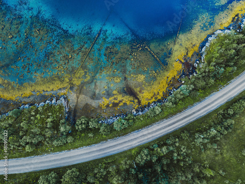 Keuken foto achterwand Luchtfoto beautiful aerial landscape with pattern of blue water, road and green forest, view from drone