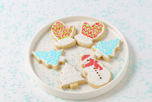 Festive Christmas Snowman Cookie With Decorated Trees On White Background.
