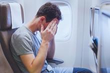 Headache In The Airplane, Man ...