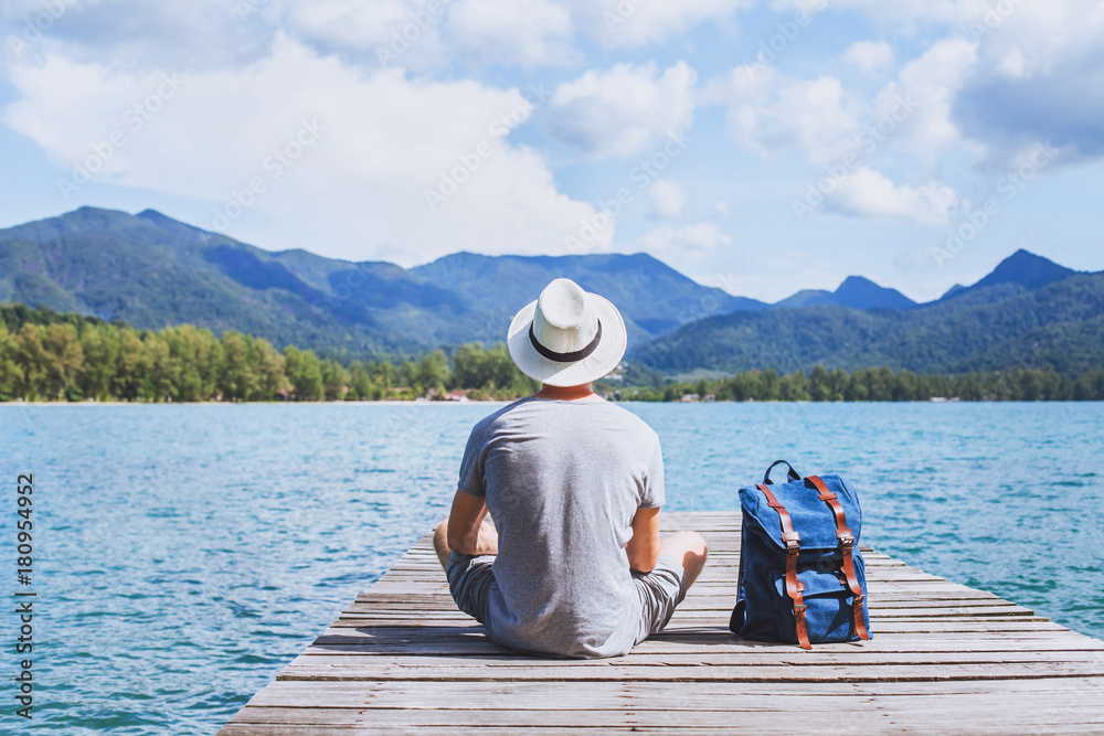 Fototapety, obrazy: summer travel, young romantic man tourist wanderlust sitting on wooden pier