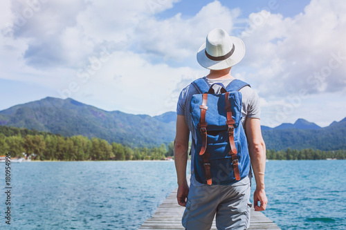 Fotomural wanderlust travel, young tourist traveler with backpack ready for summer beach o