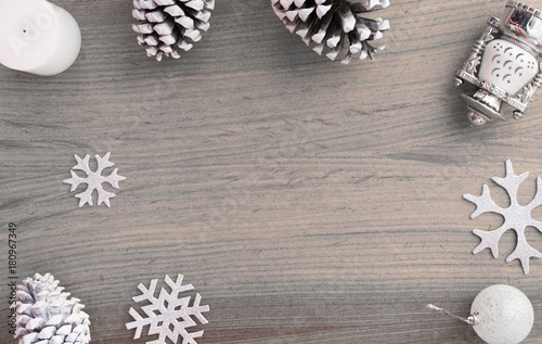 eb0108701d69 Top view on nice Christmas gift wrapped in white gift paper, tree  decorations on white wooden white background with sparkling stars. New Year