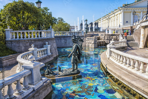 View of the Alexander Garden near Moscow Kremlin and fountain on Manezh Square at summer sunny day