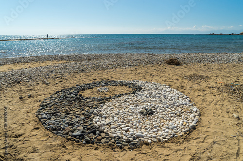 Fotografie, Obraz  Yin and yang sign made of stones on a beach