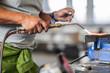 Cropped view of man welding in bodywork repair shop