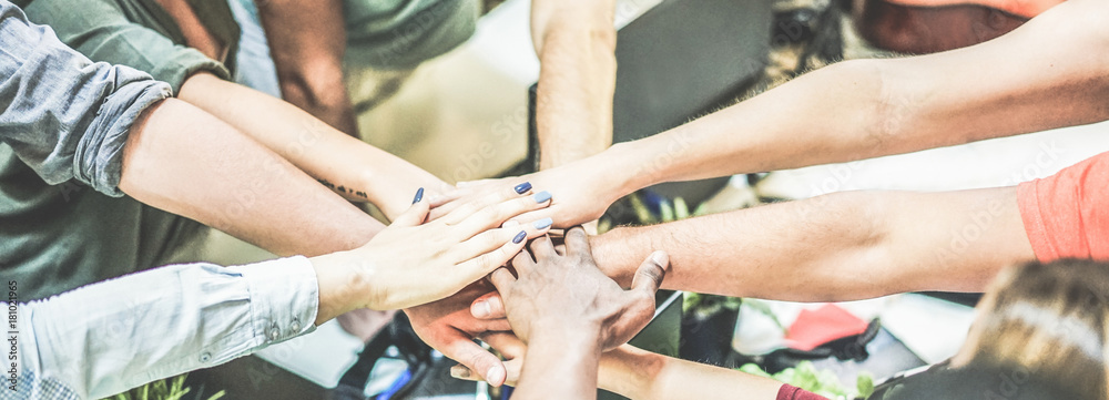 Fototapeta Work team stacking hands together for new startup project