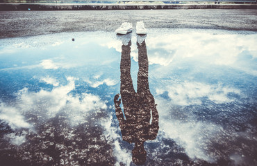 Reflection of man standing near puddle, Style is a reflection of your attitude and your personality,Education begins the gentleman, but reading, good company and reflection must finish him.