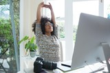 Graphic designer stretching her arms