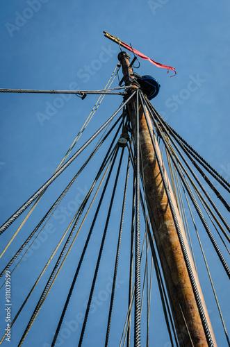 Fotografie, Obraz  Vintage ship mast and ropes with modern navigation