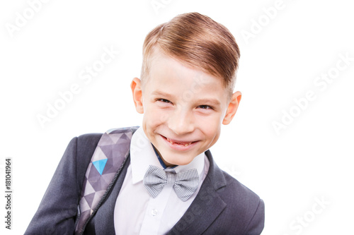 Portrait of happy schoolboy with backpack isolated on white background Poster
