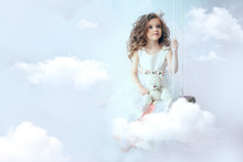 Little Girl Is Sitting On The Cloud