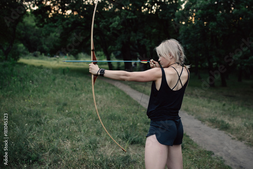 Photo Girl shoots a bow