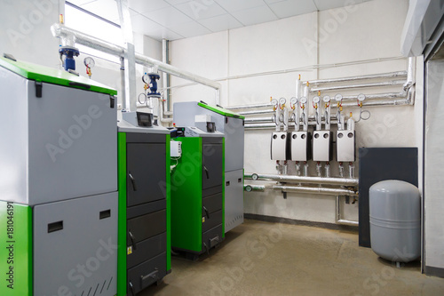 Photo  Large industrial boiler room with appliance using pallets as a fuel
