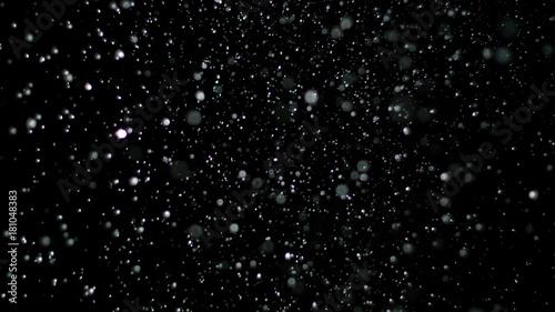 Cuadros en Lienzo Snowfall Bokeh Lights on Black Background, Shot of Flying Snowflakes in the Air