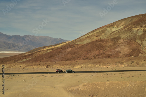 Poster de jardin Desert de sable micro-camper and Mini Cooper car in vast desert landscape