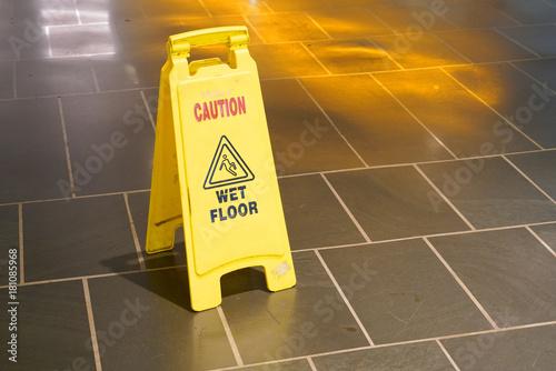 Fotografie, Obraz  Slippery when wet warning sign in doors on the floor