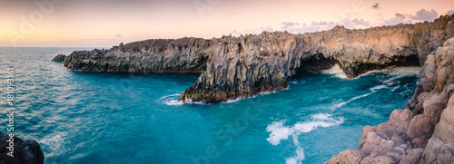 Cote Panorama of the stunningly beautiful lava caves and cliffs on the coast in Los Hervideros after sunsett. Lanzarote. Canary Islands. Spain