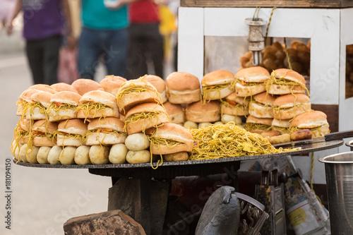 Deurstickers Bakkerij Maggi Noodle Burgers Sold By a Street Vendor in Amritsar, India