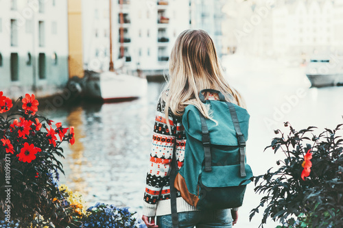 Obraz Tourist woman with backpack sightseeing walk in Alesund city Norway vacations weekend Travel Lifestyle fashion outdoor - fototapety do salonu