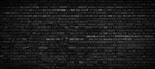 Black Brick Wall Background.