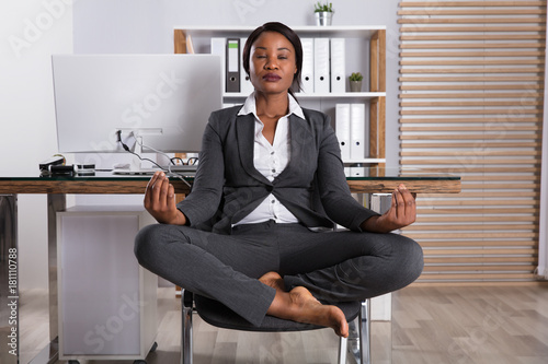 African Woman Meditating On Chair