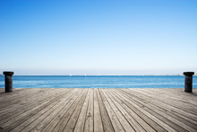 Empty Wooden Floor With Blue Sea In Blue Sky