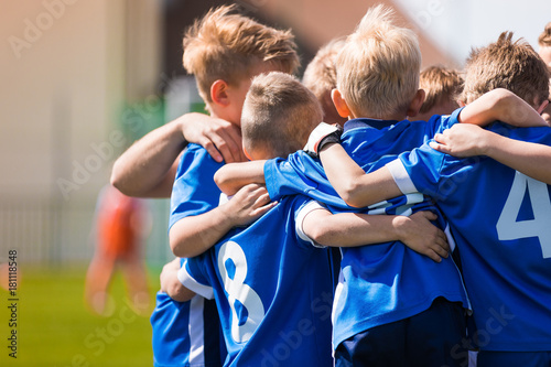 fototapeta na ścianę Kids Play Sports. Children Sports Team United Ready to Play Game. Children Team Sport. Youth Sports For Children. Boys in Sports Uniforms. Young Boys in Soccer Sportswear