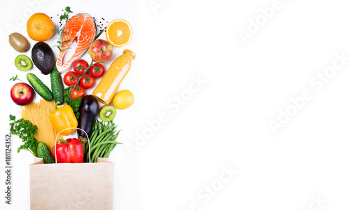 Poster Cuisine Healthy food background. Healthy food in paper bag fish, vegetables and fruits on white. Shopping food supermarket concept. Long format with copy space