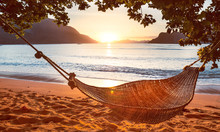 Traditional Braided Hammock In The Shade At Sunset On A Tropical Island