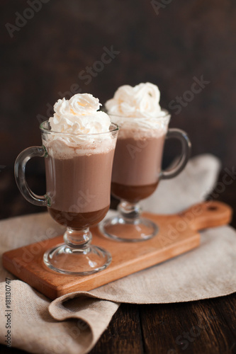 Foto op Plexiglas Chocolade Hot chocolate garnished with whipped cream and cocoa powder.