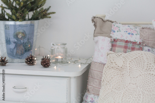 c66a704bcddf4 christmas tree in pot on white nightstand - Buy this stock photo and ...