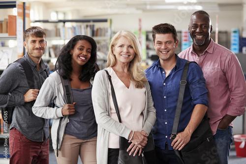 Obraz na plátně  Portrait Of Mature Student Group Standing In Library
