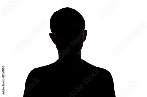 Fotomural  black and white silhouette of an unknown young man on a white isolated backgroun