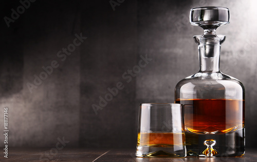 Photo Composition with glass and carafe of hard liquor