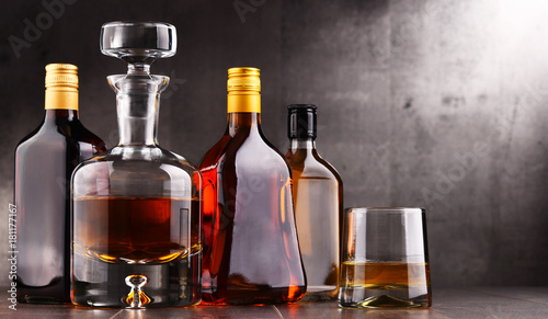 Foto op Canvas Alcohol Carafe and bottles of assorted alcoholic beverages.