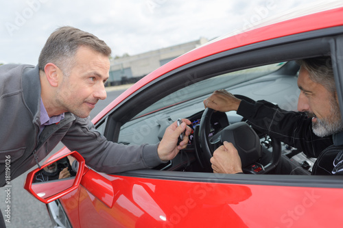 Fotografering  engineer showing stopwatch to race pilot