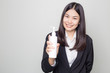 Beautiful office business women with cosmetic bottle