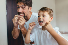 Father And Son Cleaning Teeth ...