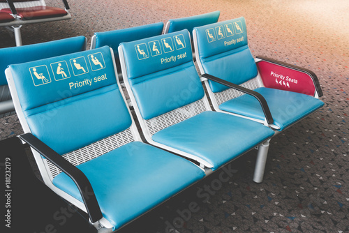 Priority seats in international airport reserved for disability, pregnant, child, senior people and monk. Set of priority seats.