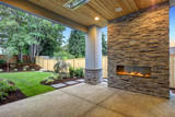 Fototapeta Kamienie - Outside Patio boasts gorgeous stone Fireplace
