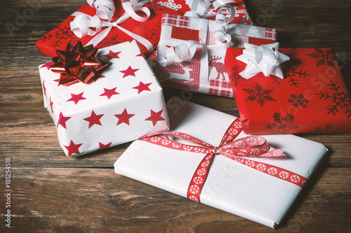Red and white christmas presents on wooden table Canvas Print