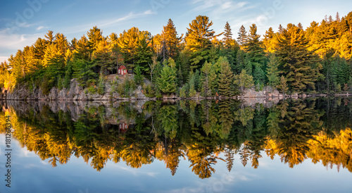 Autumn fall colours reflecting in lake Wallpaper Mural